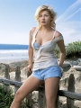 Elisha Cuthbert posing at the seaside