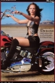 Jennifer Connelly posing on Harley Davidson