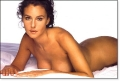 Monica Bellucci posing nude in the bedding