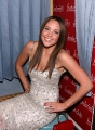 Amanda Bynes laughing in tight dress