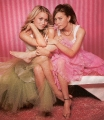 Cute Olsen Twins posing in fantastic dresses