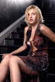 Elisha Cuthbert in fantastic dress posing on the stairs