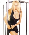 Pamela Anderson wearing black hot dress with plunging neckline