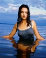 Wet Katie Holmes posing in the water