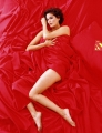 Teri Hatcher posing nude covered with red bedding