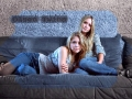 Olsen Twins are posing on the couch