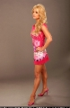 Jessica Simpson posing in hot pink dress