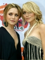 Cute Olsen Twins are posing together on the red carpet