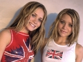 Olsen Twins are posing together wearing UK symbols