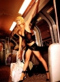 Paris Hilton riding subway in awesome dress